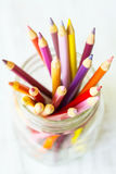 Red Orange Yellow Colored Pencils In Glass Jar From Above Royalty Free Stock Photography
