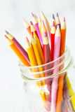 Red Orange Yellow Colored Pencils In Glass Jar On White Stock Images