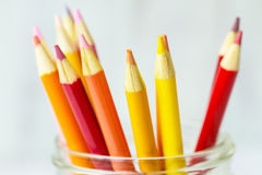 Red Orange Yellow Colored Pencils In Jar Stock Photo