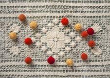 Red, orange and yellow crochet beads stock image