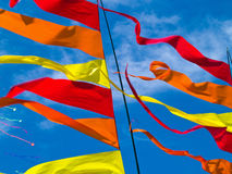 Red, Orange, and Yellow Flags Waving Royalty Free Stock Photos