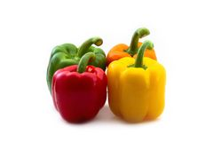 Red, orange, yellow and green Paprikas Stock Image