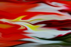 Red orange abstract background, waves like shapes. Red orange yellow green waves like shapes, fluid forms and colors, abstract design Stock Photo