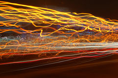 Red, orange and yellow moving lights. Shot on a highway with long exposure Royalty Free Stock Photography