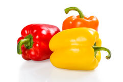 Red, orange and yellow paprika isolated Stock Images