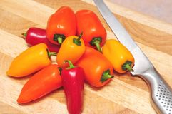 Red, orange and yellow peppers Royalty Free Stock Photography