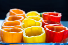 Red, orange and yellow peppers getting prepared for cooking Royalty Free Stock Photography