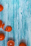 Red oranges on blue background stock photo