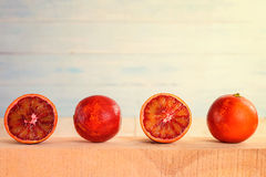 Red oranges on a wooden surface. Front view Royalty Free Stock Photo