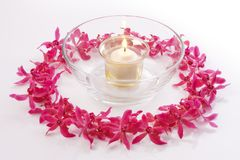 Red orchid circle with bowl and candle Stock Photography