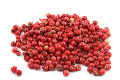 Red organic pepper. Grains of red organic pepper on white bacckgound Stock Image