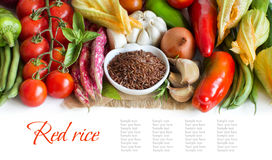 Red organic rice in bowl and fresh vegetables Stock Photography