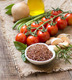 Red organic rice, olive oil, vegetables and herbs Stock Image