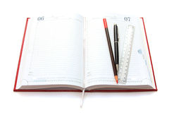 Red organizer, line and pen. Various office supplies isolated on a white Royalty Free Stock Photos