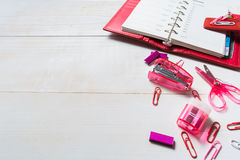 Red organizer and pink stationary on the wooden table Stock Images