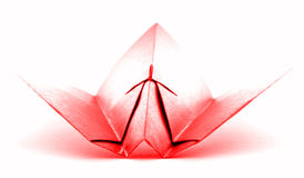 Red origami aircraft, paper plane model isolated on white background Stock Images
