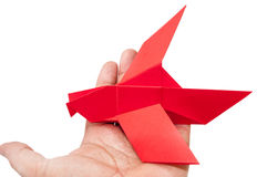 Red origami bird sitting on the hand Royalty Free Stock Images