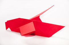 Red origami bird on a white background Stock Images