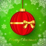 Red origami Christmas ball with golden ribbon Royalty Free Stock Photo