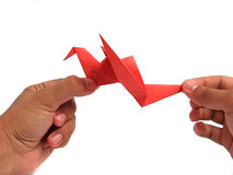 Red origami crane Stock Images