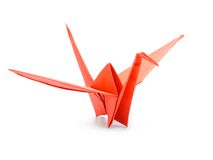 Red origami crane. Traditional Japanese origami crane made from red paper over white background royalty free stock images