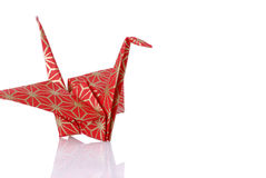Red Origami Peace Crane. With reflection royalty free stock images
