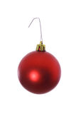 Red ornament hanging on white. Shot of a red ornament hanging on white Stock Photography