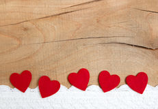 Red ornamental hearts on a wooden background for christmas, anni Royalty Free Stock Photo