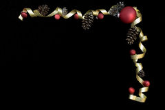 Red ornaments and gold ribbon Royalty Free Stock Images