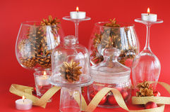 Red ornaments in jar, candles and pine cones Stock Photos