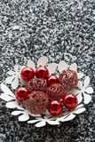 Red ornaments in leaves shape plate Royalty Free Stock Photo