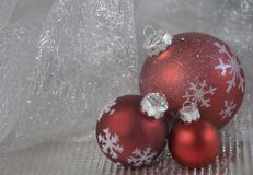 3 red ornaments and silver back ground. Red ornaments and silver back ground merry Christmas greeting card and happy new year stock photography
