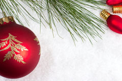Red ornaments in snow Stock Image