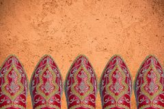Red oroccan shoes, header background.  Royalty Free Stock Images