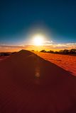 Red sand dune with ripple and blue sky Stock Photo