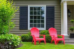 Red Outdoor patio Chairs on Front Yard green Lawn Stock Photography