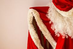 New Years is soon. The red outfit of Santa Claus hangs on a chair. Approaching the holiday, the New Year, the fulfillment of desires Stock Images