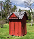 Red Outhouse Stock Photo