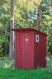 Red outhouse Royalty Free Stock Photo