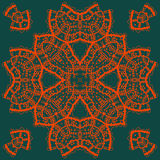 Red outlined mandala medallion on green . Vintage Royalty Free Stock Photography