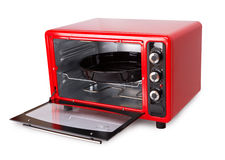Red oven. Kitchen red oven isolated on a white background Royalty Free Stock Photography