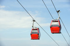 Red Overhead Cable Cars Blue Sky Royalty Free Stock Images