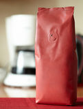 A red packet of coffee without a label. On the kitchen table royalty free stock photos