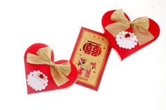 Red packets and candy packaging. Chinese-style wedding candy  packaging and red packets on white Stock Photo