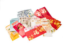 Red packets with Good Fortune character and various currency not Royalty Free Stock Photo