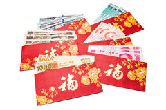 Red packets with Good Fortune character and various currency not Royalty Free Stock Image