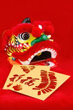 Red packets and lion head Royalty Free Stock Image