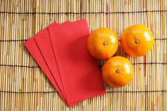 Red packets and mandarin oranges Royalty Free Stock Photo