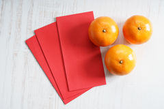 Red packets and mandarin oranges Stock Photography