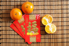 Red packets and mandarin oranges, golden Chinese letter means lu Royalty Free Stock Image